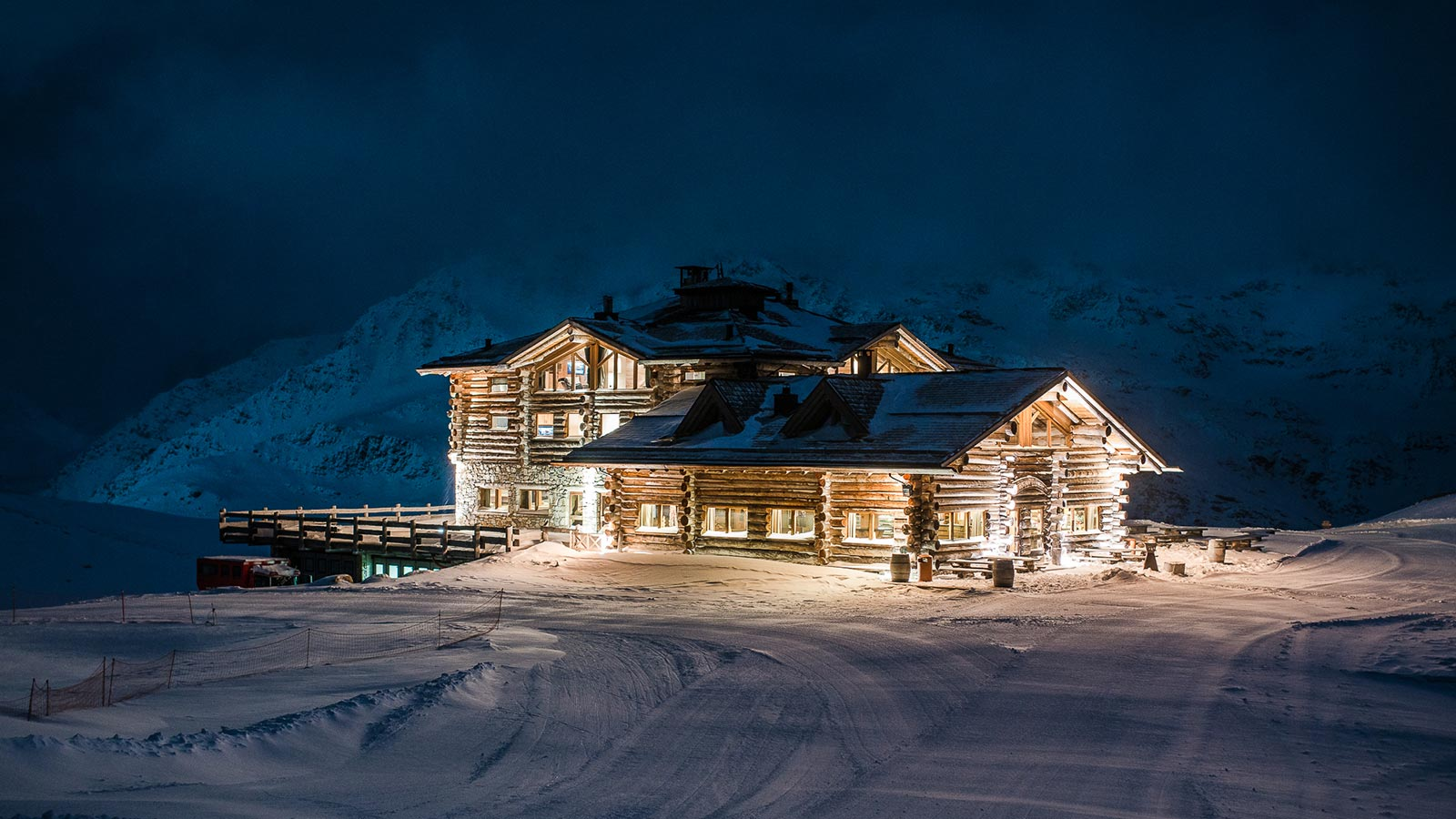 The mountain lodge at night shines with lights