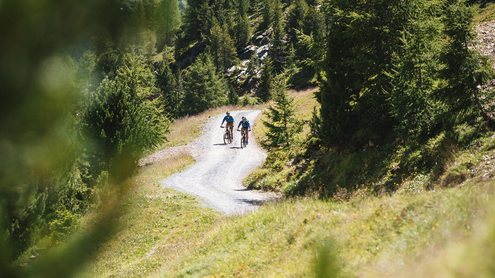Two bikers on a summer hike around the Sunny Valley Mountain Lodge