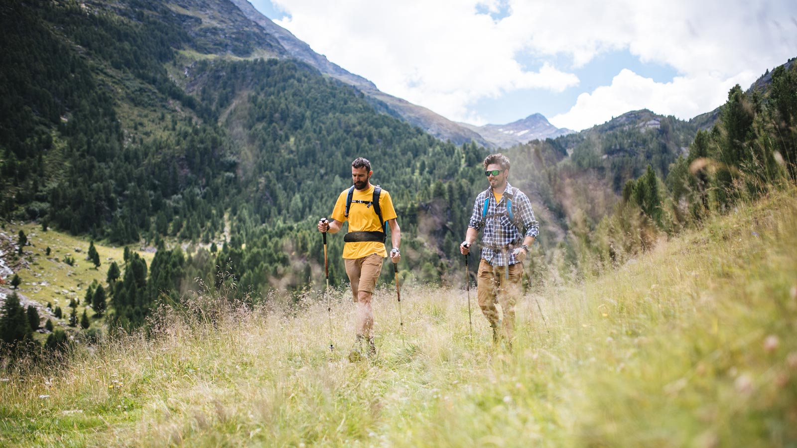 Two boys on a hike in nature at Santa Caterina Valfurva