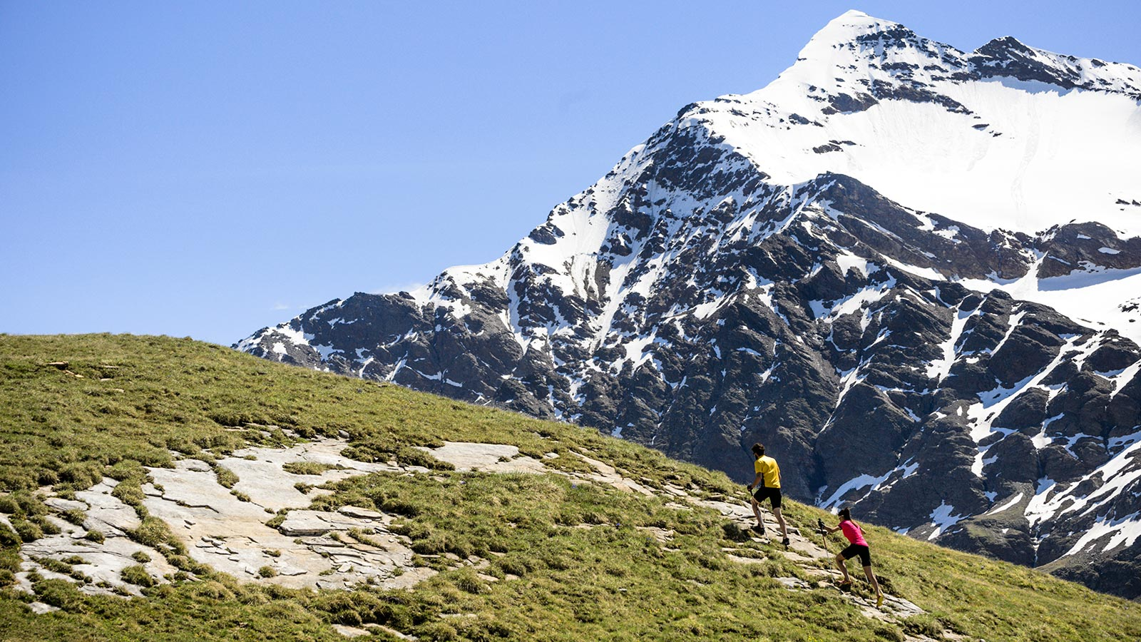 Man and woman hiking in the province of Sondrio
