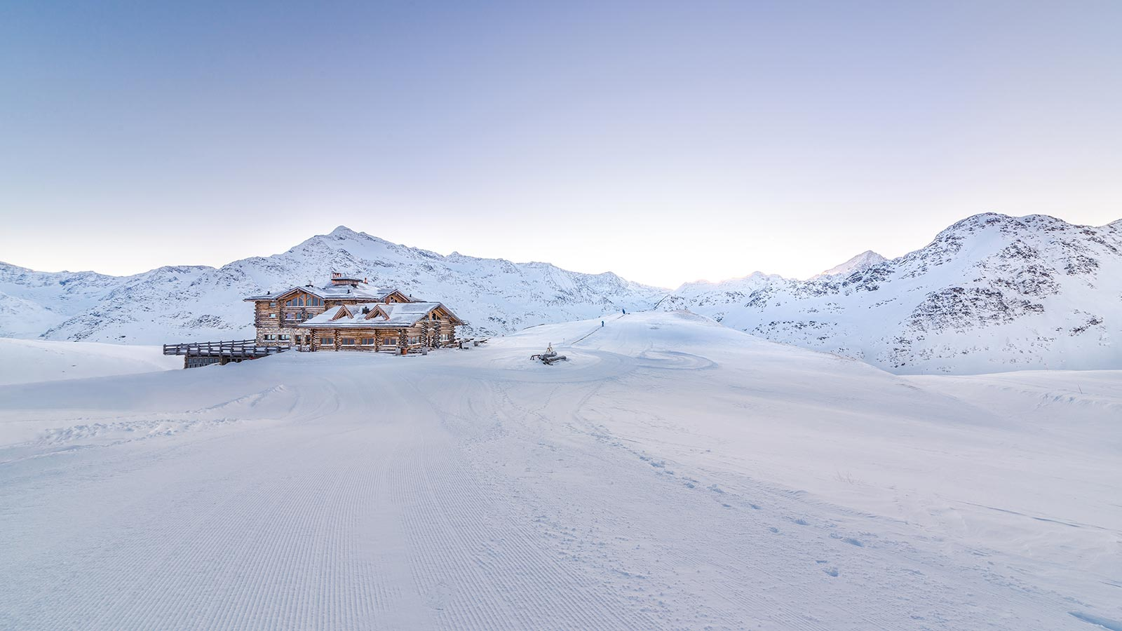 Mountain lodge on an idyllic snow-covered landscape